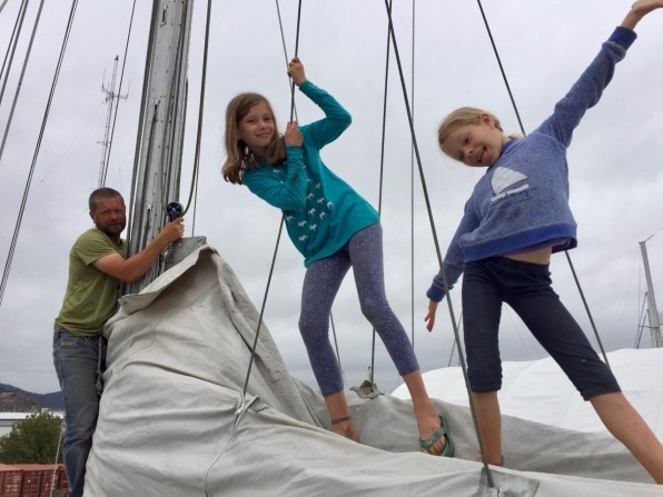 C'mon, girls. Let's get this sail up.