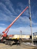 PT Rigging attaching the crane to the mast